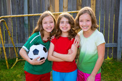 Three sister girls friends soccer football winner players Stock Images