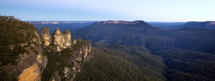 Three Sisters. The Three Sisters, Katoomba, Blue Mountains, New South Wales, Australia.  At sunset, panoramic view Stock Image