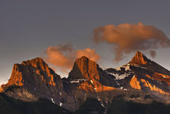 Three Sisters. The Three Sisters mountains in Canmore Alberta Canada's Rocky Mountains at sunrise Stock Photos