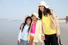 Three sisters on the beach Royalty Free Stock Photo