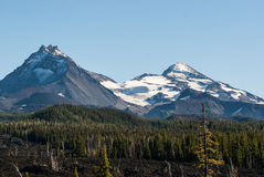 The Three Sisters in the Cascade Mountains of Oregon.. Looking south over the lava fields  toward Faith and Hope two of the Three Sisters Mountains  in central Royalty Free Stock Photo