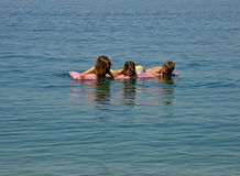 Three sisters enjoy on sea Royalty Free Stock Photos