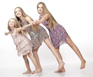 Three sisters joy and fly. Royalty Free Stock Photos