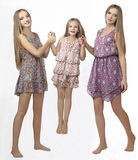 Three sisters jump and play Stock Images