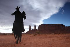 Three Sisters Monument With Cowboy Silhouette Royalty Free Stock Photo