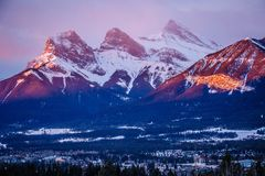 Three sisters mountain view at sunrise time in Canmore town, Canada. Three sisters mountain view at sunrise time in Canmore town in Canada, Canadian Rockies royalty free stock photos