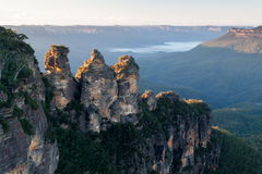 Three Sisters Mountains. The vast expanse of the Blue Mountains in Australia. One of the most visited tourist attractions showing the Three Sisters mountains royalty free stock image