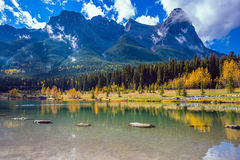 The Three Sisters mountains. Shining day in Canmore. The famous Three Sisters mountains in the Canadian Rockies. Concept of hiking Royalty Free Stock Image