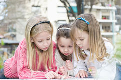 Three sisters in the park Royalty Free Stock Photo