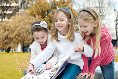 Three sisters in the park Stock Image