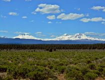 The Three Sisters. Three Sisters peaks as seen from US Hwy 20 near Sisters, OR - Cascade Range royalty free stock photos