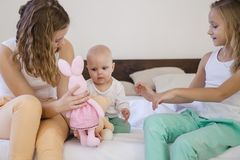 Three sisters play children in the morning in the bedroom Royalty Free Stock Photos