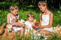 Three sisters play toys in Park Stock Image