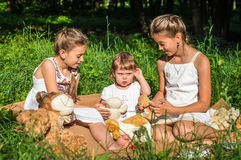 Three sisters play toys in Park Stock Photography