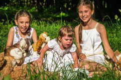 Three sisters play toys in Park Stock Images