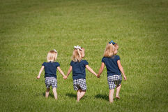 Three sisters playing Royalty Free Stock Image