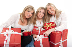 Three sisters with presents Royalty Free Stock Photography