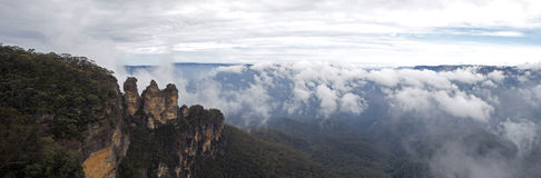 Three Sisters rock formation. The Three Sisters are a famous rock formation in the Blue Mountains of New South Wales, Australia. They are close to the town of Stock Images