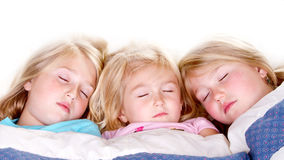 Three sisters sleeping in bed Royalty Free Stock Photography