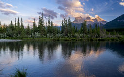 Three Sisters at sunset. Along the Bow River in Alberta Canada Stock Photos