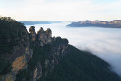 The Three Sisters surrounded by morning fog Stock Images