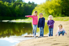 Three sisters and their brother having fun Royalty Free Stock Image