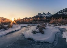 Sunrise above The Three Sisters, Canmore, Travel Alberta, Banff National Park, Canada, North America, Canadian Rockies royalty free stock image