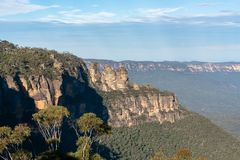 Famous Three sisters rock From Around Echo Point formation - Their names are Meehni, Wimlah, and Gunnedoo. The Three Sisters are an unusual rock formation in royalty free stock photo