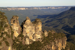 Three Sisters Valley. One of Australia's most famous tourist landmarks: the Three Sisters rock formation at Katoomba in the Blue Mountains of New South Wales Royalty Free Stock Photography