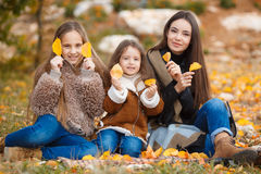 Three sisters on walk in autumn Park Royalty Free Stock Photo