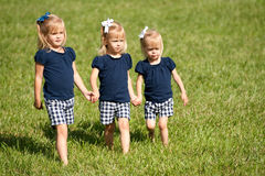 Three sisters walking in a field royalty free stock photography