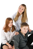 Three sitting teens Royalty Free Stock Photography