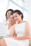 Three sitting women Royalty Free Stock Photography