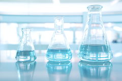 Three size of blue glass flask in science laboratory Stock Image