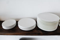 Three size white ceramic plate on the wood shelf Stock Images