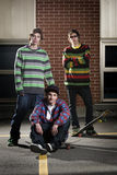 Three skateboarder friends together Royalty Free Stock Photography