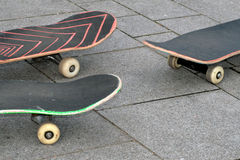 Three skateboards. Detail of three skateboards on the ground Royalty Free Stock Photo