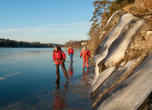 Three skaters. Three scandinavian skaters on a frozen lake Royalty Free Stock Photography