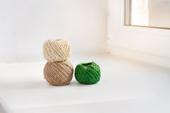 Three skeins of thread. On the windowsill stock photography