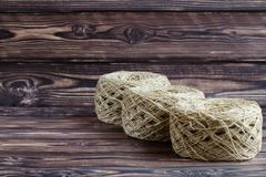 three skeins of yarn for knitting ball on a dark background stock images