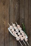 Three skewers with boiled shrimps Royalty Free Stock Images