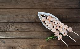 Three skewers with boiled shrimps Royalty Free Stock Image