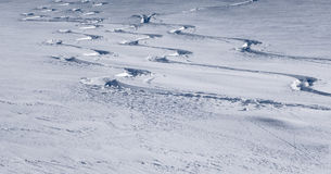 Three ski tracks showing turns in fresh powder snow Stock Photo