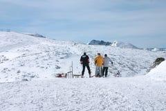Three skiers. Ready to ski down the mountain Royalty Free Stock Photography
