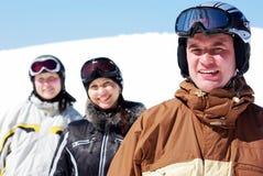 Three skiers. Three happy skiers resting on ski resort Royalty Free Stock Photo