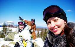 Three skiers. Three happy skiers resting on ski resort Stock Photos
