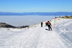 Three skiers descend from the peak. Sunny winter day on Cherni Vrah, Vitosha Mountain, Bulgaria Stock Photography