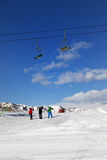 Three skiers on slope at sun day Stock Image