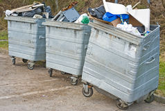 Three skips overflowing with rubbish. royalty free stock images