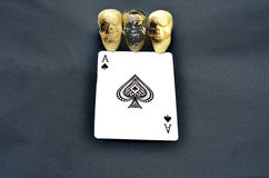 Three Skulls with Ace of Spades Royalty Free Stock Image
